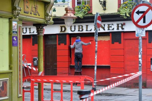 NO ORDERS: The Auld Dubliner Pub in Temple Bar, Dublin, as its boarded-up windows get painted. Photograph: Alan Betson