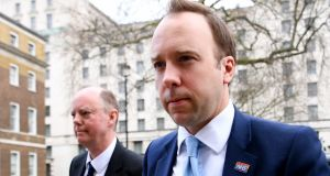 Health secretary Matt Hancock, who has tested positive for coronavirus, and chief medical officer Chris Whitty, who is self-isolating with symptoms. Photograph: EPA/Andy Rain