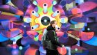 A man wearing a face mask walks past a mural depicting a coronavirus Covid-19 cell in Dublin on Saturday. Photograph: Aidan Crawley/EPA