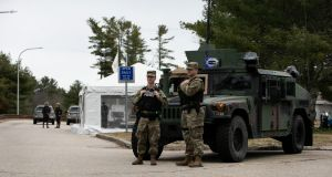 The National Guard and Rhode Island State Police at a checkpoint at the Rhode Island-Connecticut state border on Saturday to advise New Yorkers to maintain a 14-day quarantine after arriving leaving the state. Photograph: Kayana Szymczak/The New York Times