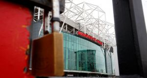 A view of locked gates at Old Trafford, home of Manchester United. Photo: Martin Rickett/PA Wire