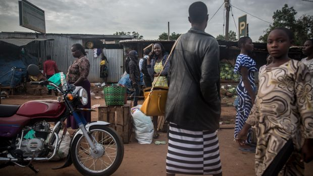 Residents walk near a market in Gulu, northern Uganda. Restrictions are increasing because of the coronavirus outbreak. Photograph: Sally Hayden