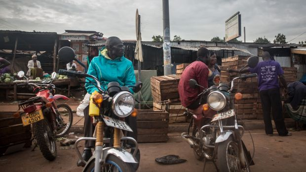 Boda boda drivers in Gulu, northern Uganda. Public transport has been banned because of the coronavirus outbreak. Photograph: Sally Hayden