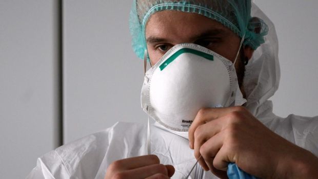 'What if the much needed personal protective equipment doesn't arrive ahead of a big surge in patients?' Above, a nurse puts on PPE in Italy. Photograph: Marco Bertorello/AFP via Getty