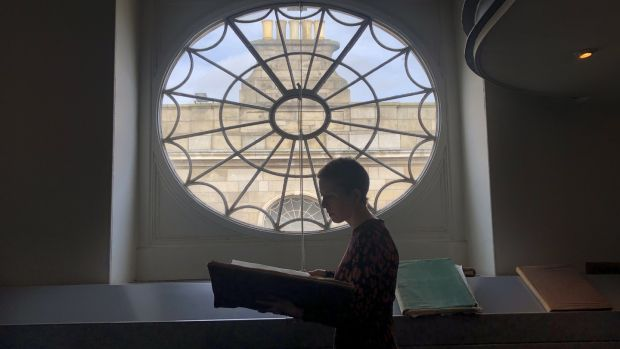 "Archives manager Ellen Murphy at the Registry of Deeds office: ""Wills might have information about the jewellery the person had, and the furniture in the house, or money left to a nurse."" Photograph: Bryan O'Brien"