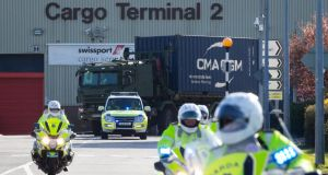 Army vehicles with vital Covid-19 medical supplies just in from China leave Dublin Airport with a Garda escort. Photograph: Tom Honan