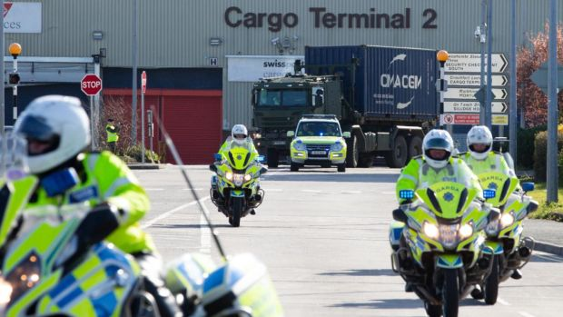Army vehicles escorted by An Garda leave Dublin Airport with a cargo of newly delivered Covid-19 equipment just in from China. Photograph: Tom Honan