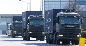 Defence Forces vehicles transport personal protective equipment from  Dublin Airport after its arrival from China. Photograph: Tom Honan