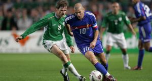 Kevin Kilbane tries to close down Zinedine Zidane during a qualifier for the 2006 World Cup, where the French midfielder would steal the show again. Photograph: Morgan Treacy/Inpho