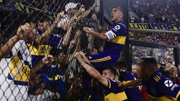 Carlos Tevez celebrates with Boca Juniors fans after scoring the goal to win the league last month. Boca ultras feature heavily in James Montague's book. Photograph: Gustavo Garello/Jam Media/Getty Images