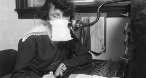 Telephone operator with protective gauze during the 1918-1919 flu epidemic:  a great many were affected.