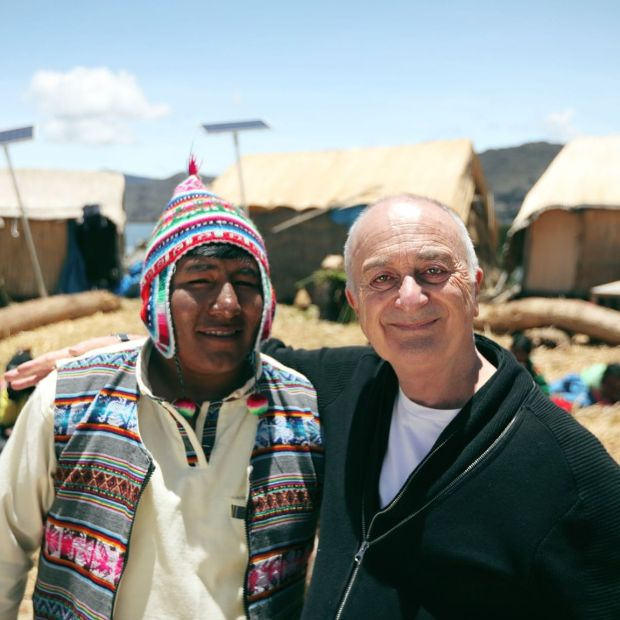Around the World by Train: Tony Robinson with one of the Uros people, who live on floating islands on Lake Titicaca, in South America. Photograph: Rumpus Media/Channel 5