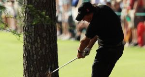 Phil Mickelson plays a six-iron from the pine straw on the 13th hole during the final round of the 2010 Masters at Augusta. Photograph:  David Cannon/Getty Images