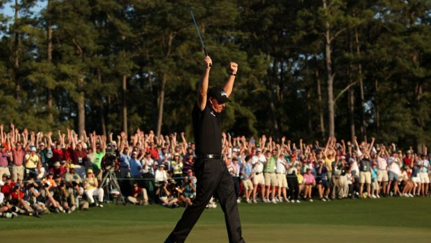 Phil Mickelson celebrates his three-stroke victory after winning the 2010 Masters at Augusta.Photograph: Andrew Redington/Getty Images