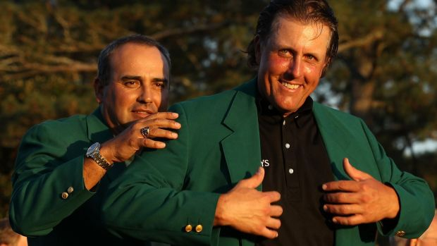 Angel Carbrera presents Phil Mickelson with his green jacket after his win in 2010. Photograph: Streeter Lecka/Getty Images for Golf Week
