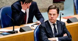 Wopke Hoekstra sits behind Dutch prime minister Mark Rutte. Mr Hoekstra wrote that issuing joint debt via bonds risked undermining 'incentives for sensible policy'. Photograph: EPA
