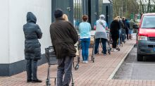 Shoppers observe social distancing while queuing outside Dunne Stores in Clonakilty, Co Cork. Photograph: Andy Gibson