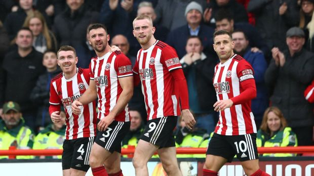 Enda Stevens (second from left) celberates with his Sheffield United team-mates after scoring his team's first goal during the Premier League match between against Brighton at Bramall Lane. Photograph: Matthew Lewis/Getty Images