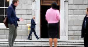 Fianna Fail leader Micheal Martin arrives at Leinster House where a debate is to take place on wether the House is essential and should still meet during this crisis. Photograph: Sam Boal/Rollingnews.ie