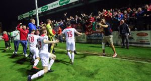 Shelbourne fans and players celebrate promotion last season. Photograph: James Crombie/Inpho