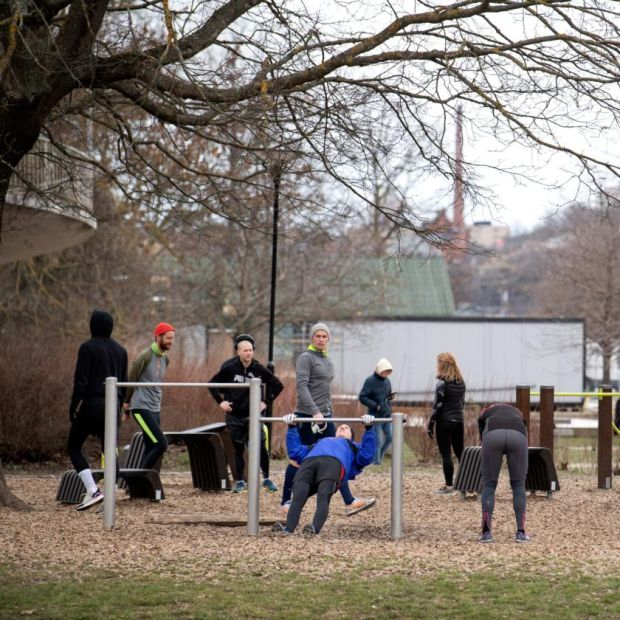 Social distancing?: people exercising in a park in Stockholm on Wednesday. Photograph: Jessica Gow/EPA