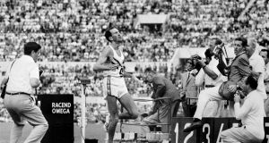 Australia's Herb Elliott crosses  the finish line to win the  Olympic 1,500m  in Rome in 1960. Photograph: AFP via Getty Images