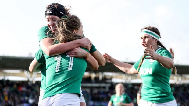 Beibhinn Parsons celebrates with Aoife McDermott and Anna Caplice after scoring Ireland's opening try against Wales. Photograph: Dan Sheridan/Inpho