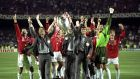 Paul Scholes and Roy Keane, who were suspended for the final, lift the European Cup. Photograph:  Alex Livesey/Allsport