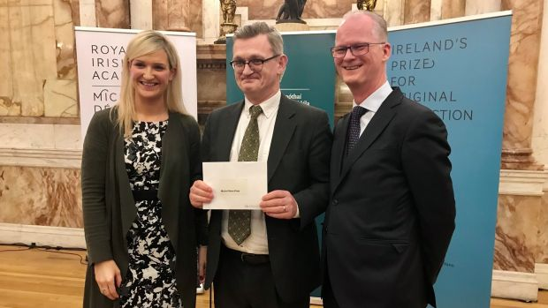 Breandán Mac Suibhne, winner of the inaugural Michel Déon Prize, with minister Helen McEntee and Michael Kennedy, president of the Royal Irish Academy