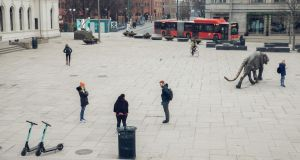 Pedestrians stand at a safe social-distance in Oslo, Norway on March 25th. Photograph: Odin Jaeger/Bloomberg