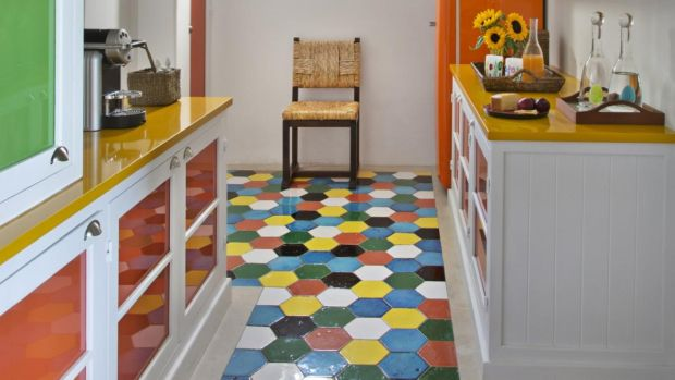 Multicoloured hexagon tiled kitchen floor, in a home on the Greek island of Mykonos, from Beige Is Not a Color, published by Vendome Press. Photograph: Jean-Pierre Vaillancourt