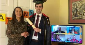 Dr Brian Gordon with his mother Marion Gordon. He dressed in a suit adorned with a Harry Potter cape pulled out of the Halloween dress-up box for his online graduation.