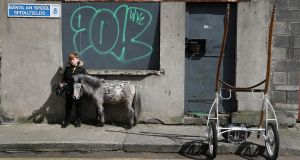 MANE MAN: Todd Carey (8) with Flash, his 2-year-old Falabella horse, and a sulky in the Spitalfields area of Dublin. Photograph: Nick Bradshaw