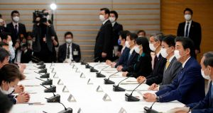 Japanese prime minister Shinzo Abe declares a state of emergency during a meeting of the task force against the novel coronavirus in Tokyo. Photograph: EPA