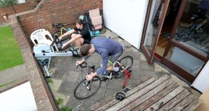 Rick Mally (rower) and Joe Hastings (bike) train at their apartment in Dublin. Photograph: Bryan Keane/Inpho