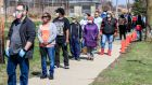 Voters wait in line in the Wisconsin presidential primary election. Photograph: Tannen Maury/EPA