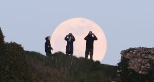 A pink supermoon rises over the Rock of Dunamase in Co Laois Photograph: Niall Carson/PA