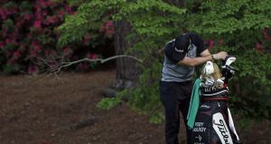 Rory McIlroy  leans on his golf bag on the 13th hole during the final round of the 2011 Masters  as things unravelled for him in Augusta, Ga. Photograph: /Matt Slocum/AP