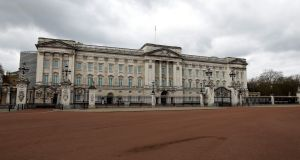 A deserted Mall in front of Buckingham Palace, in London, as life in Britain continues during the nationwide lockdown to combat the coronavirus pandemic. Photograph:  Tolga Akmen/AFP/Getty
