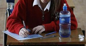 One proposal under consideration is that results would be awarded based on predicted grades which could also take into account past-exam performance. File photograph: Niall Carson/PA