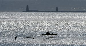 AT BAY: A lone kayaker practises social distancing in Dublin Bay. Photograph: Alan Betson/The Irish Times