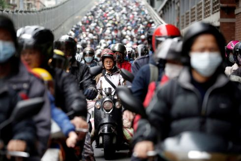 CORONAVIRUS: Commuters wear face masks to protect themselves from coronavirus during morning rush hour traffic, in Taipei, Taiwan. Photograph: Ann Wang/Reuters