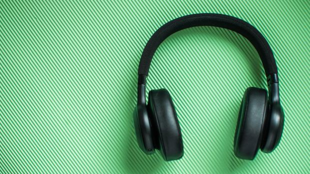 Get your headphones on and listen in to the 50 best podcasts around. Photograph: Getty