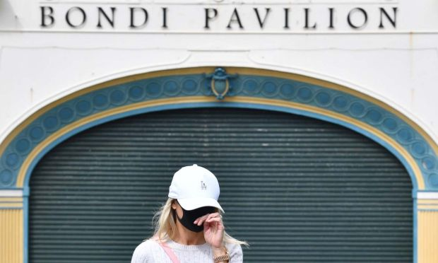 Coronavirus clusters: a Bondi resident leaves a Covid-19 testing clinic in Sydney. Photograph: Dean Lewins/EPA
