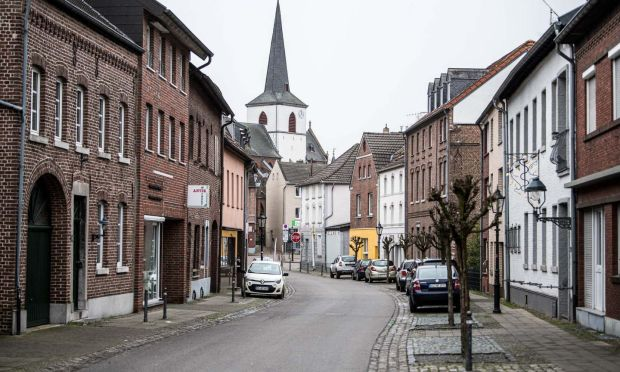 Coronavirus clusters: a deserted main street in Gangelt, Germany. Photograph: Lukas Schulze/Getty