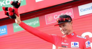 Nicolas Roche wearing the leader's red jersey  in Alicante during the 2019 Vuelta a España. Photograph:  Jose Jordan/AFP via Getty Images