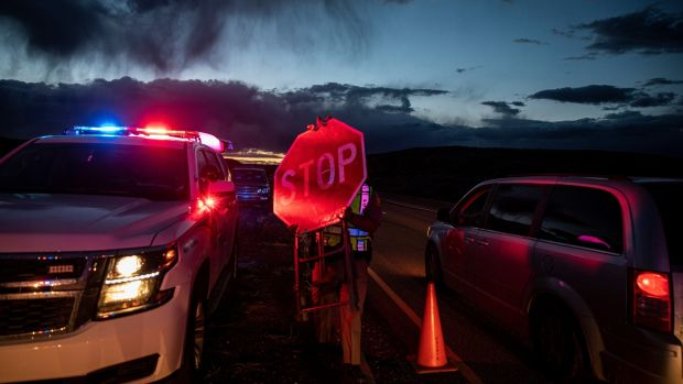 Navajo police officers set up a road block in Window Rock, Arizona, in response to the coronavirus pandemic. Photograph: Adriana Zehbrauskas/New York Times