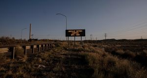 A road sign about the Navajo nation curfew, outside of Gallup, New Mexico.  Photograph: Adriana Zehbrauskas/New York Times