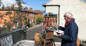 'EN PLAIN AIR':The artist Gerard Byrne who normally paints 'en plain air' (in the outdoors) and is known for his landscape and architectural paintings has set up his easel on the roof of his Ranelagh studio. Photograph: Bryan O Brien