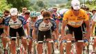 Spain's Miguel Indurain in the yellow jersey  is protected by his team-mates Marino Alonso (left) and Pedro Delgado (centre) during the 17th stage of the 1992 Tour de France. Photograph: Boris Horvat/AFP via Getty Images